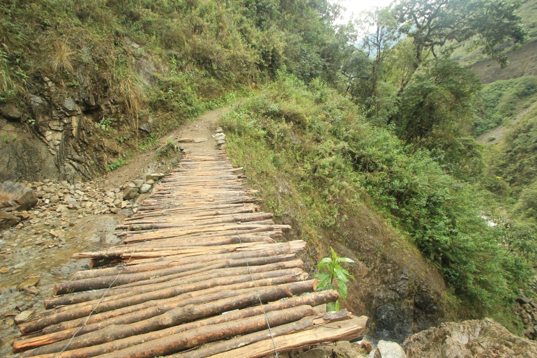 Precarious bridge with a sheer drop? All in a day's work on the Salkantay trek.